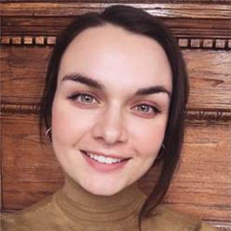 Headshot of Alexa Collesides