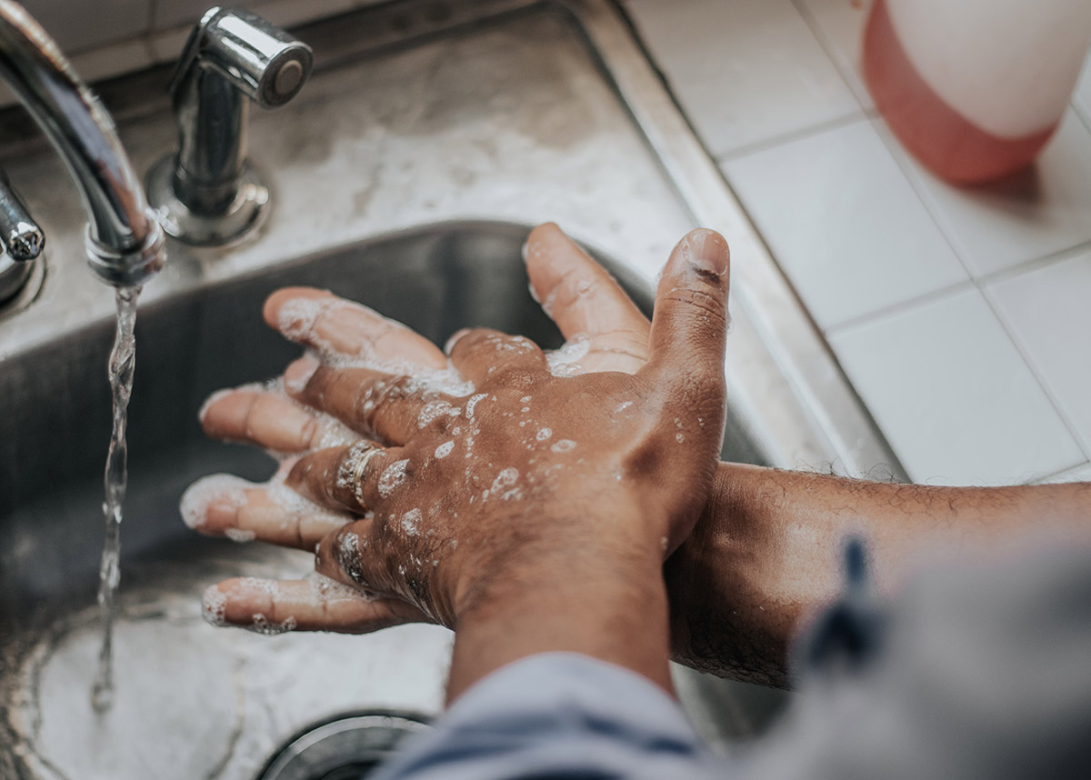 hands washing under faucet