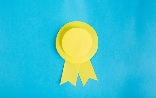 yellow award on blue background