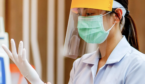 Healthcare worker with face mask and shield