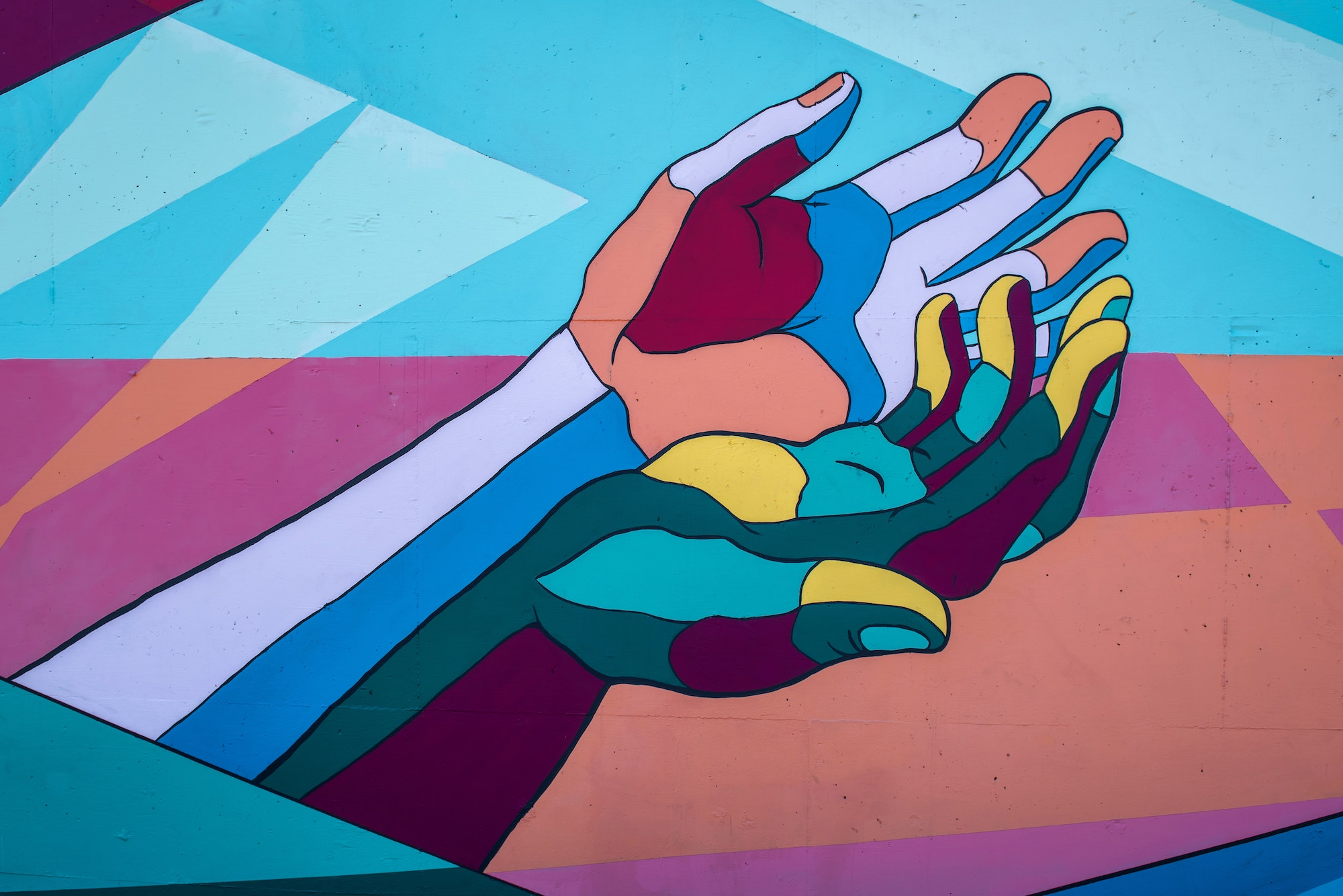 Mural with colorful painted hands