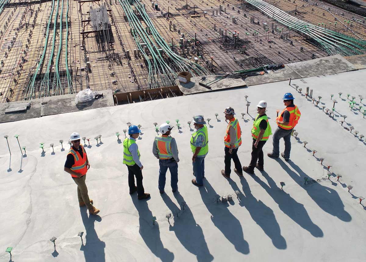 a group of construction workers wearing hard hats