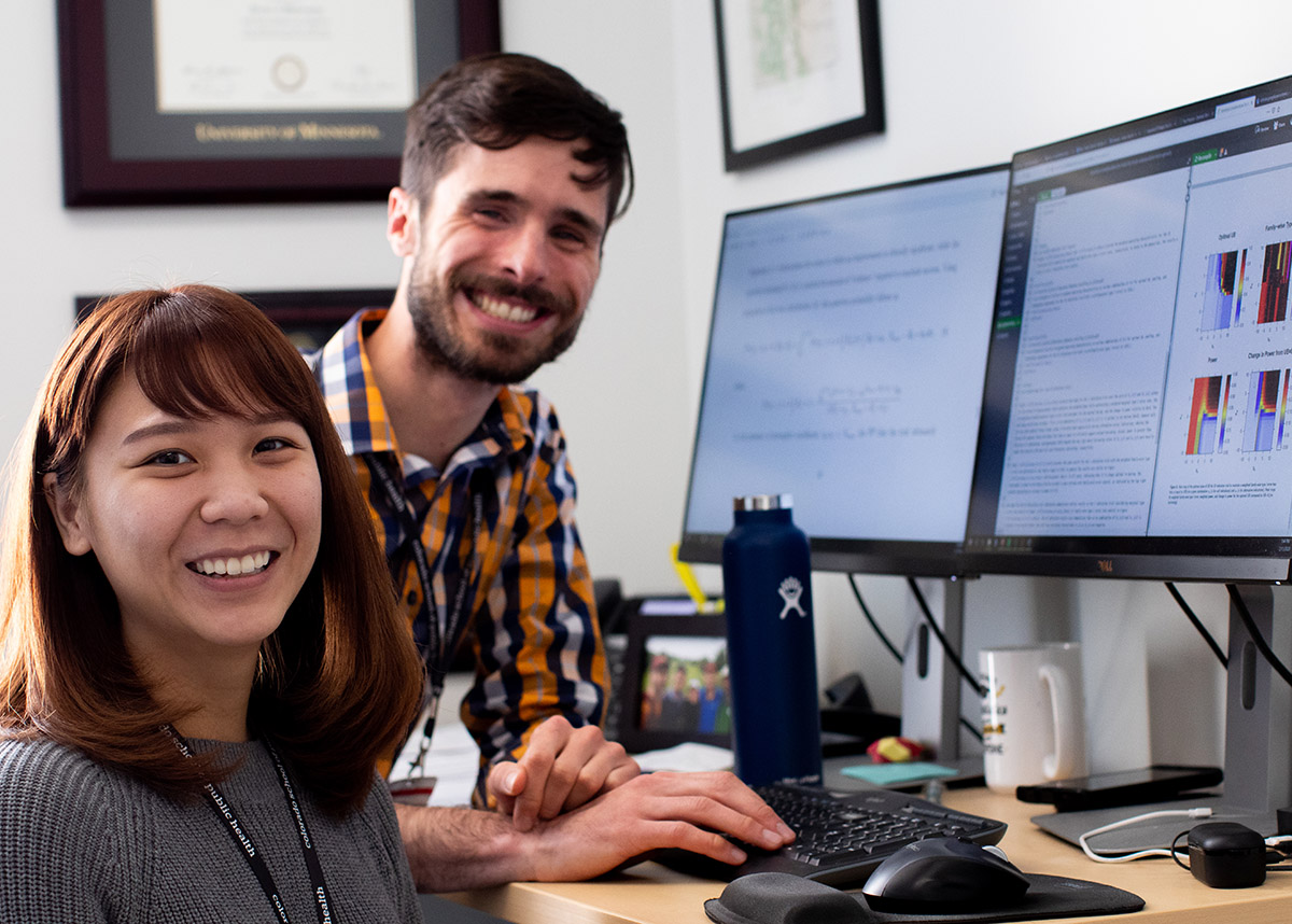 photo of two team members at computer