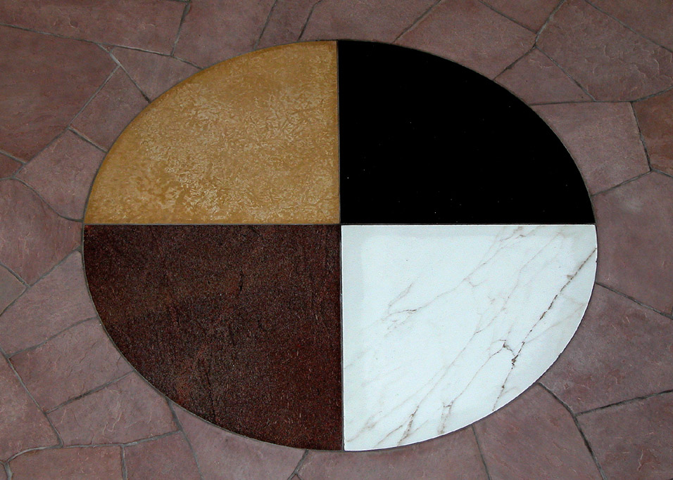 Floor tiling in building that represents the medicine wheel and the four sacred directions