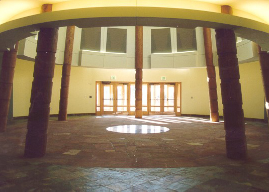 Interior of the building showcasing the rotunda, a circular room outlined by tipi poles