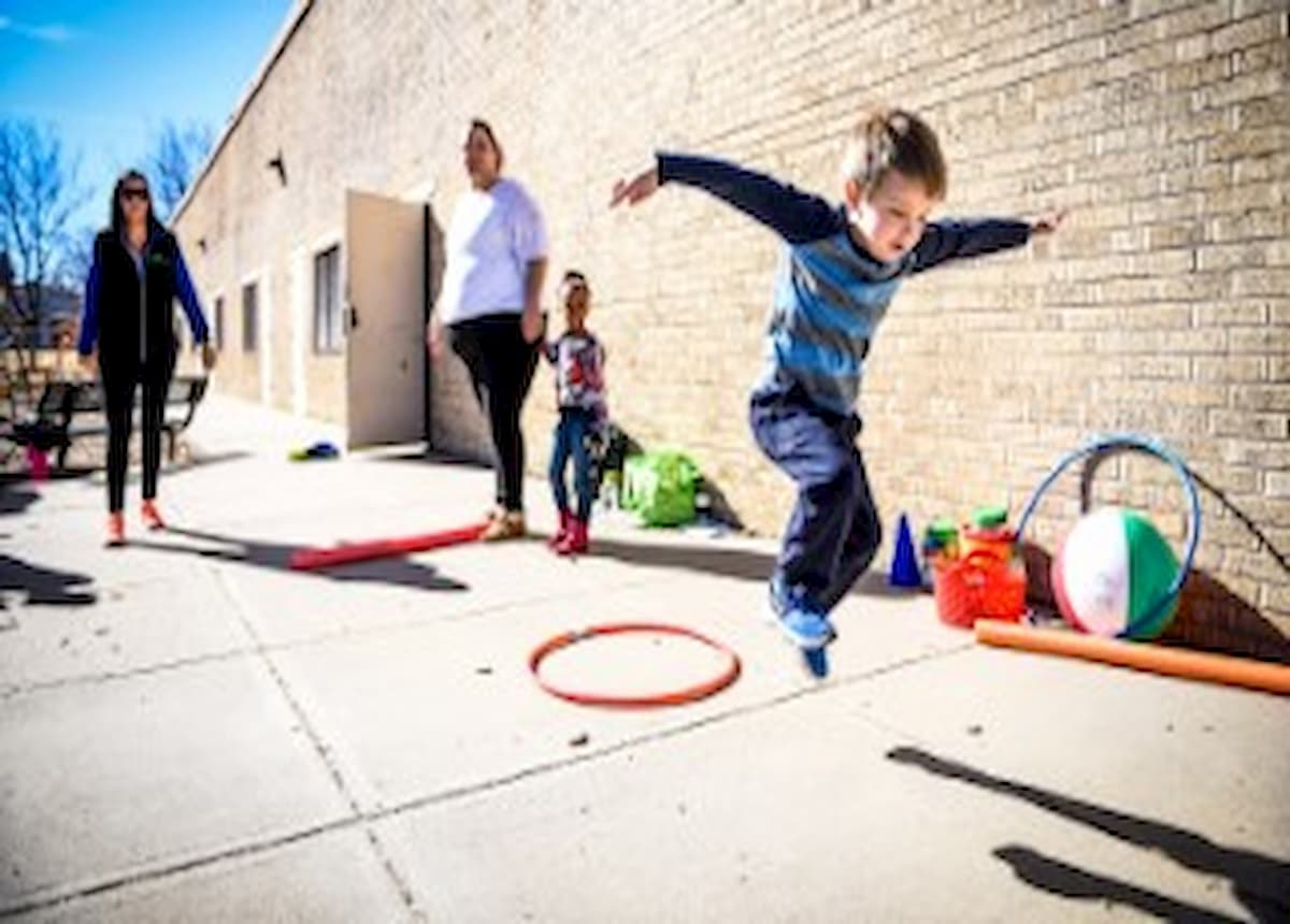 Boy playing hop scotch at a school in the San Luis Valley.