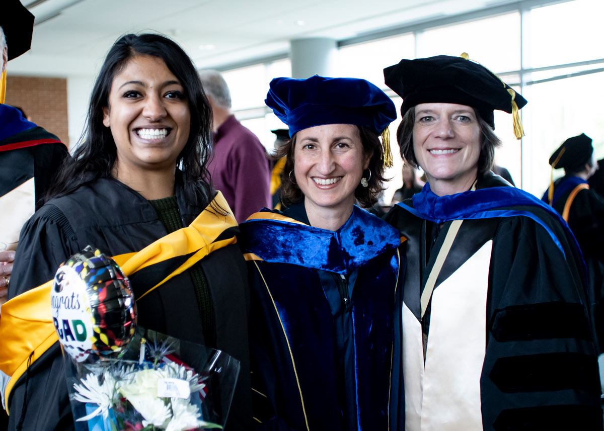 ColoradoSPH graduate and two professors