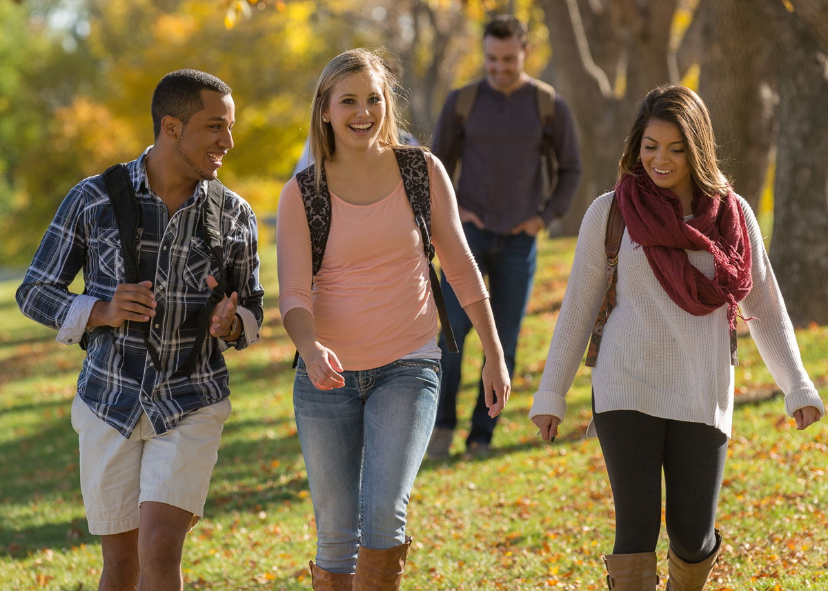 three students walking on UNC campus