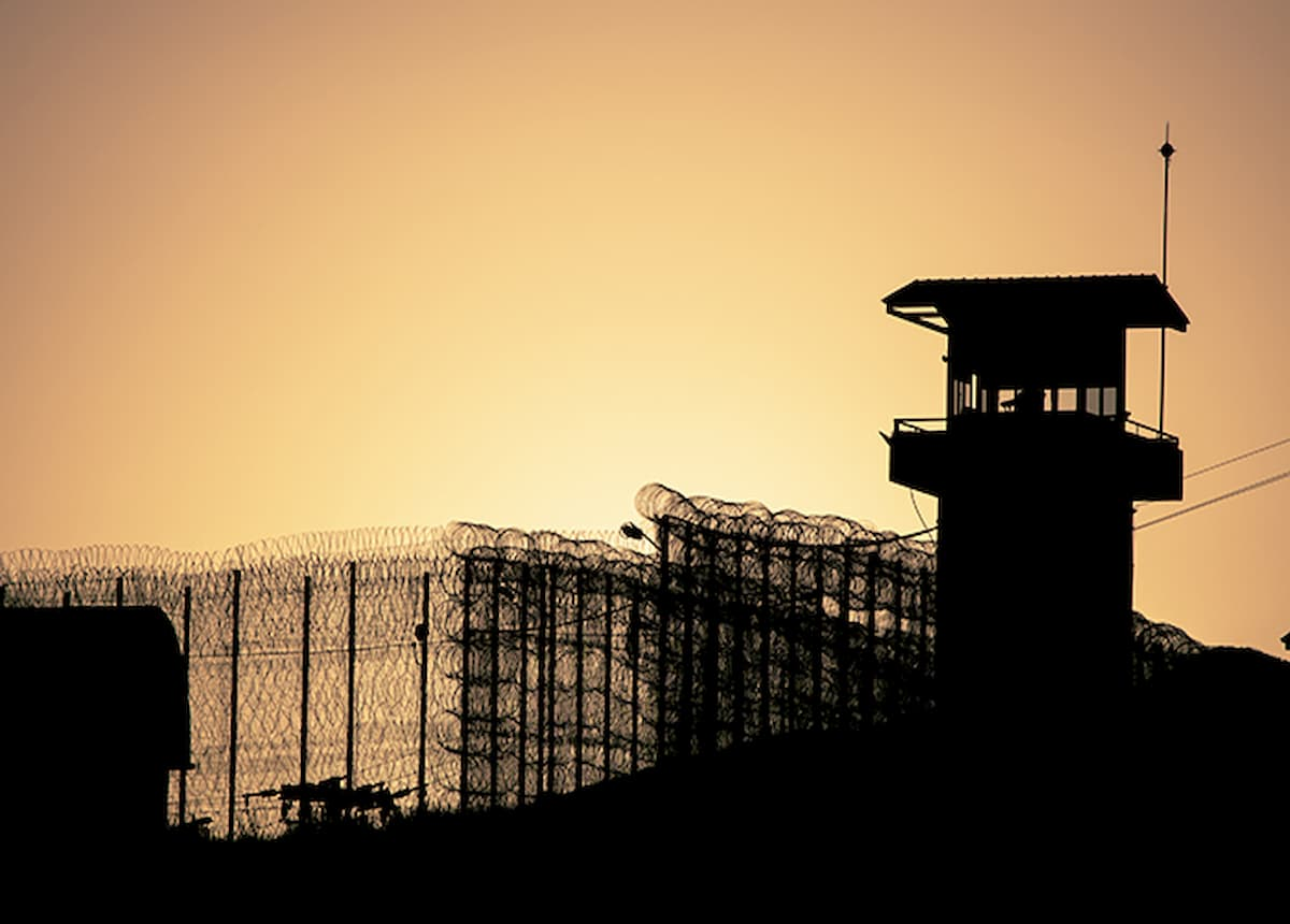 Silhouette of a prison guard tower