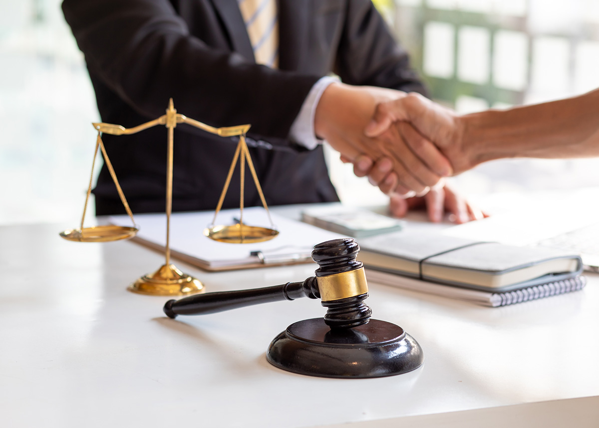 lawyer shaking hands with someone