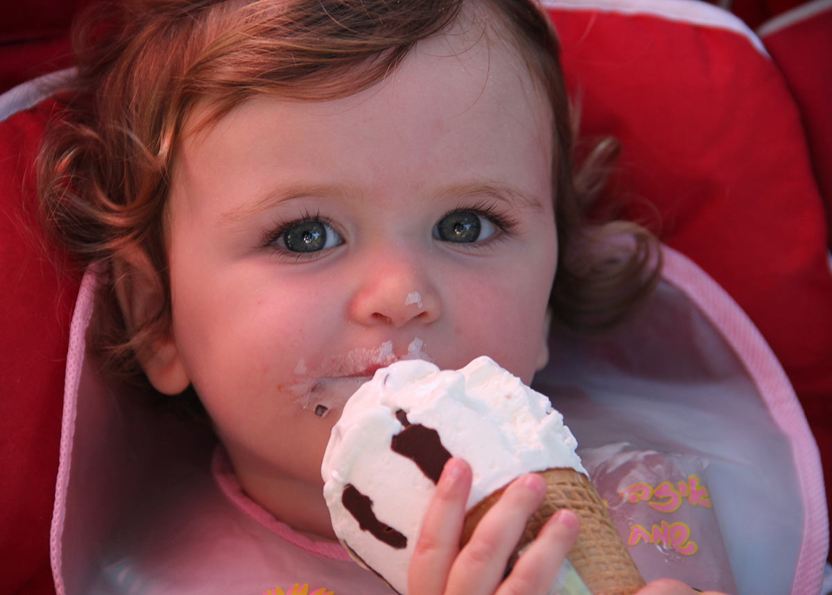 young child eating ice cream