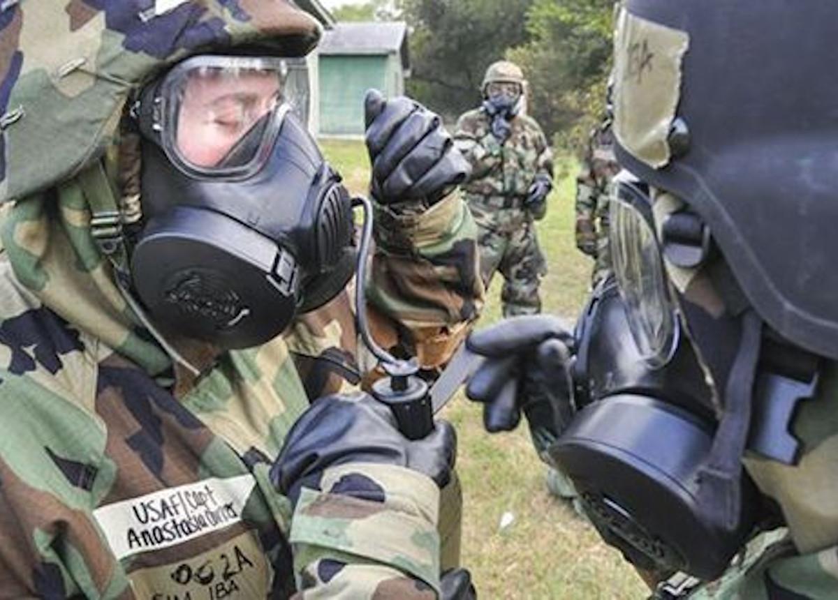 people wearing hazmat equipment
