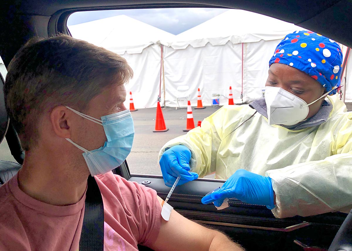 person getting vaccinated at a drive up clinic