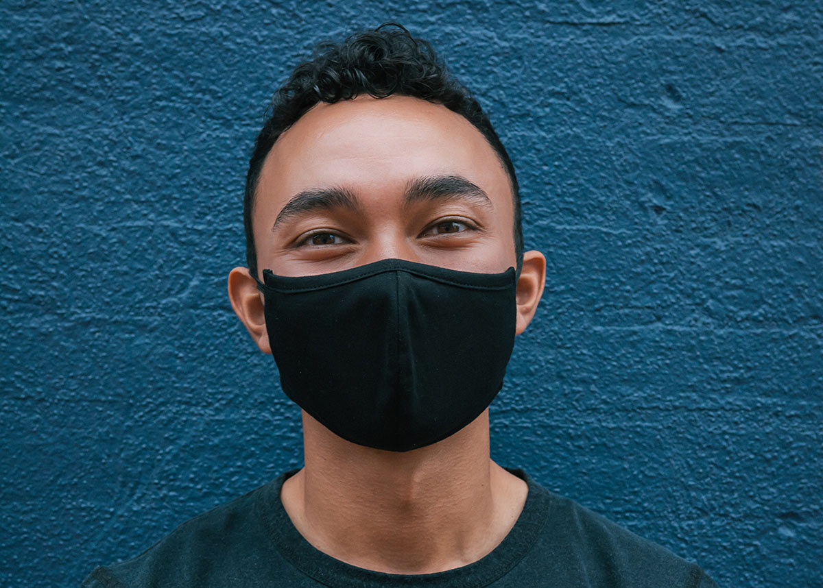 young man wearing a mask
