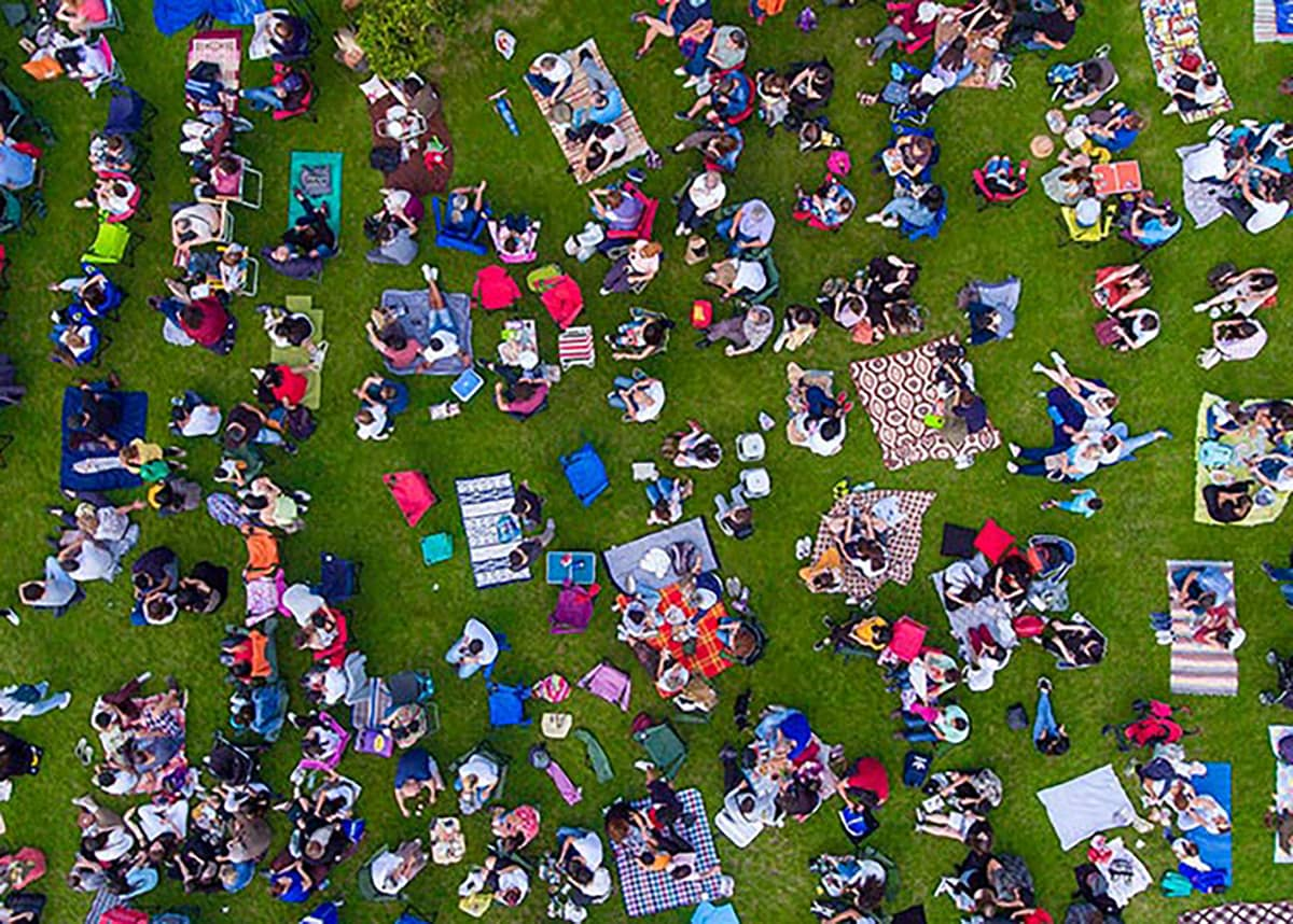 A crowd of people sitting outside