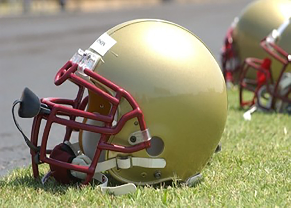 Football helmets on ground