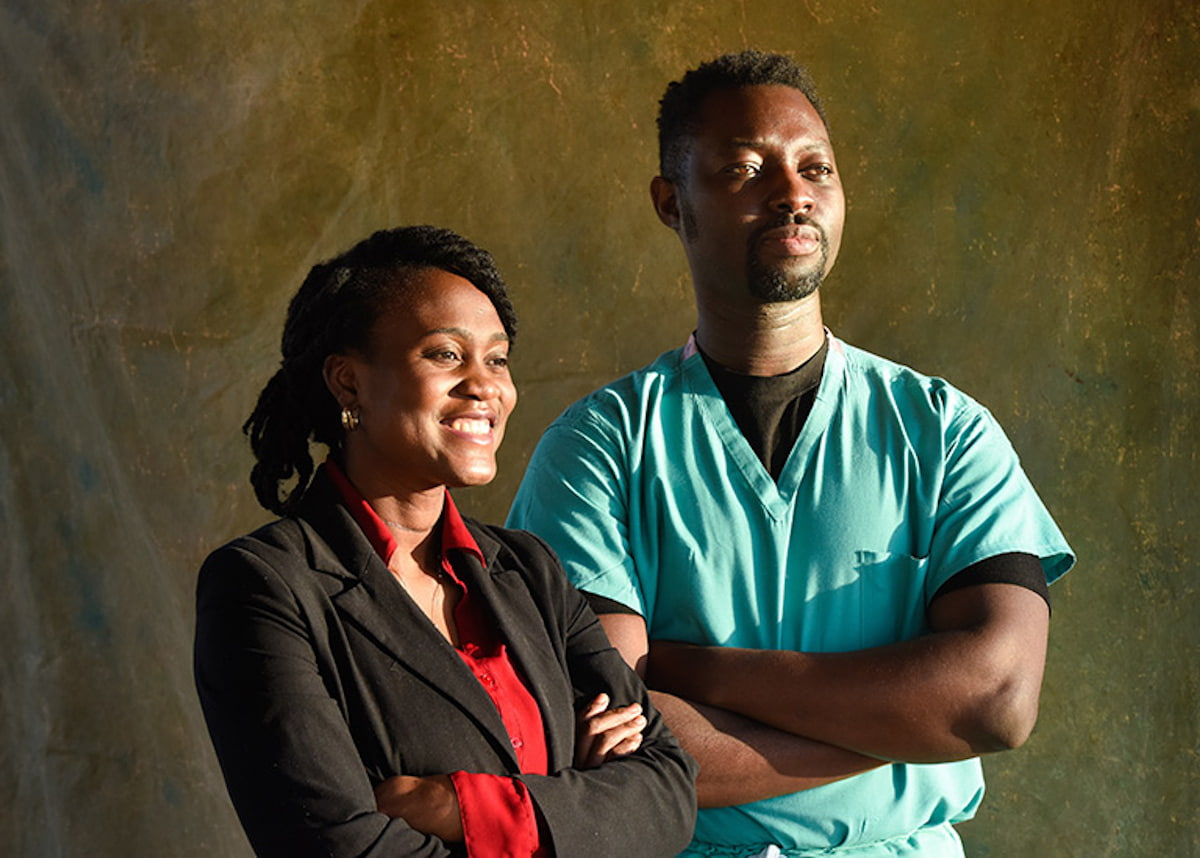 Doctors Cynthia and Kweku Hazel in photo with arms crossed