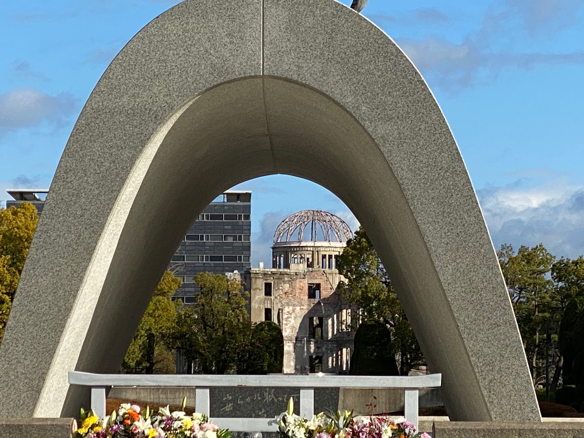 The A-Bomb Dome seen through the Peace Cenotaph at the Hiroshima Peace Park.