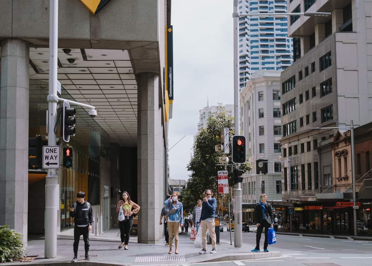 people using crosswalk wearing masks