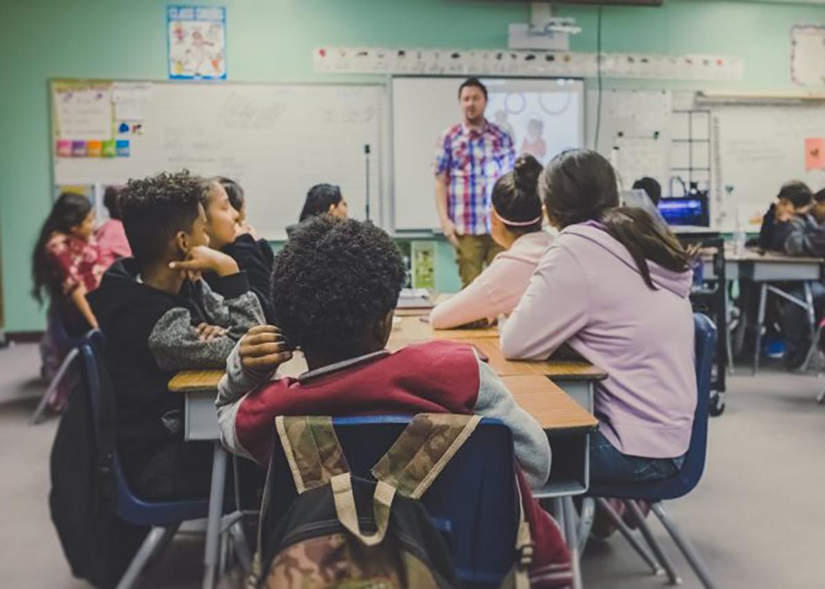 Classroom of children listening to teacher