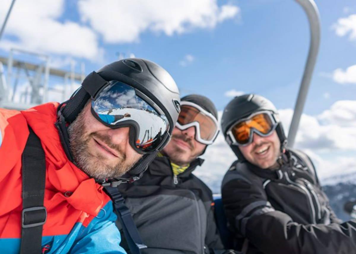 Three men enjoying a ski trip