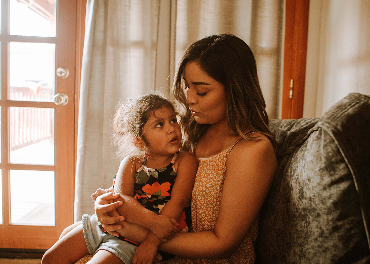 woman and child sitting together on a couch