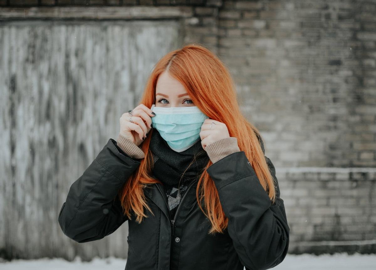 woman wearing mask looking at camera