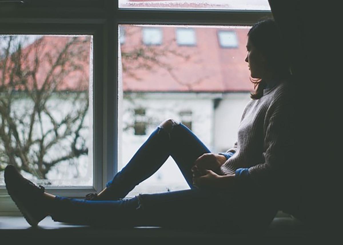 Women sitting on a windowsill