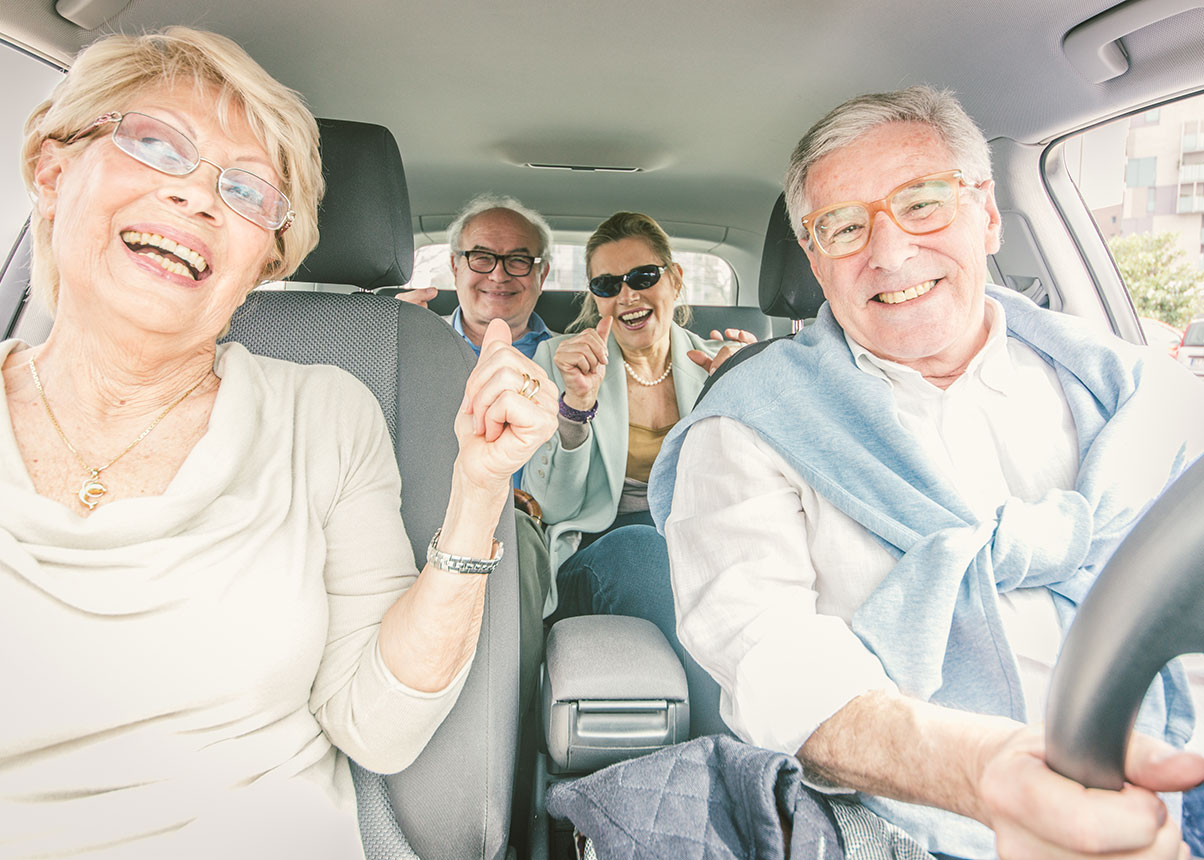 Four elderly people in a car