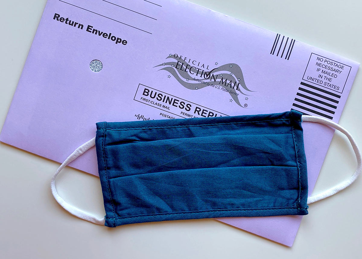 election mail envelope with face mask on top
