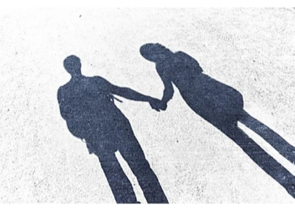shadows of man and woman holding hands