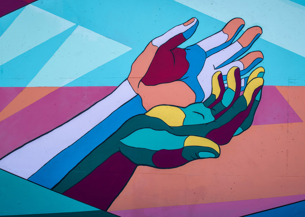hands painted in a mural